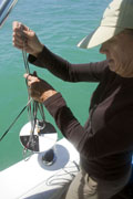 Sarasota County environmental specialist Kathy Meaux preparing to drop a Secchi disk into Sarasota Bay to assess its turbidity.
